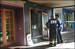 The Sawtell Fire Brigade and Coffs Harbour police investigate the crime scene at Sawtell Seaside Takeaway in Sawtell.