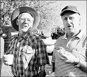 BUSH BREAKFAST: Poet Tony Kelly, left, and Tenterfield councillor Allan Rolph enjoy breakfast in the park as part of Tenterfiel