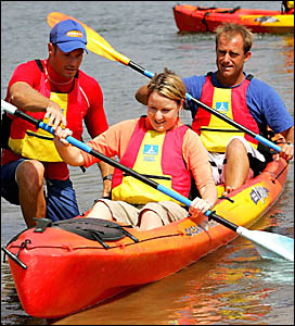 Dwayne Thuys helps Sarah Hamilton of Cudgen with her kayak while she is given lessons by  instructor Glen Murray
