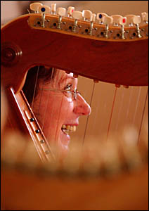 Virginia Pfeiffer looks through the line of harps at the workshop held by renowned harpist John Dalton at the weekend.