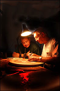 Renowned cabinet maker and marquetry exponent, Geoff Hannah, left, offers some advice to student Bob Amos, of Warwick.?