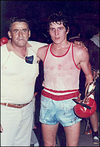 John Cooper congratulated by his father after winning a rugged and bloody fight at Grafton in 1983.