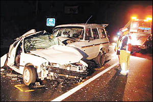 A teenage boy lost his life on the Pacific Highway yesterday morning after his hatchback collided with a Landcruiser.