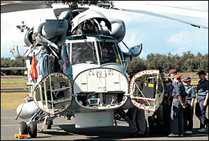 Naval Cadets from Coffs Harbour?s TS Vendetta inspect the chopper.