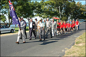 Brian Wright, of Lawrence, leads the Lawrence Anzac Day march. Brian wore the medals of his grandfather.