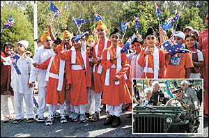Children from Woolgoolga?s Sikh community enjoy the Anzac Day march, while ex-servicemen accept the applause of the crowd.