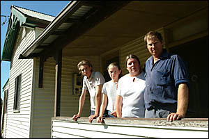 BURGLARY VICTIMS: Mathew, Emma, Amy and Kelvin Quinlivan from the Summerland Way standing on the front verandah of their house
