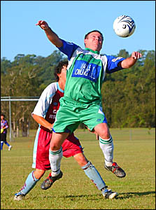 FLYING HIGH: Bobcats striker Grant Neilson flies high to control the ball on his chest.Photo: DEBRAH NOVAK.