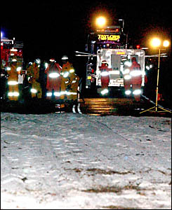 MOPPING UP: Fire crews prepare for mop up operations at the site of last night?s accident. Photo: DEBRAH NOVAK.