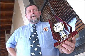 WILD ABOUT WILDLIFE:Amateur Grafton wildlife photographer Kevin Dixon with his Pakenham Camera Club trophy. Photo: JOEL HARGANS