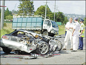 FATAL CRASH: The scene at Kyogle Road, 500 metres from the 60km/h zone at Casino Street, South Lismore, involving a car and a t