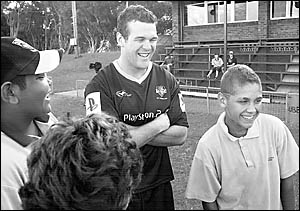 FUN AND GAMES: Jay Cohen, 13, of Ballina, has a laugh with City player Jason King during the training session held at Kingsford