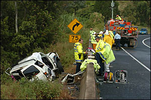 ABOVE: Police and emergency service crews work at the scene of yesterday?s accident, where a Landcruiser collided with a Ford F