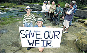 WEIR NOT HAPPY: Harvey and Lynne Kingsford, from Casino, are joined by the Casino Weir  Action Group to protest at the removal