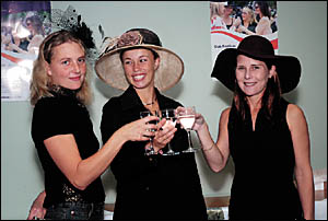 They?re racing . . . Jo, Tara and Beth lend their support to Club Festivus.