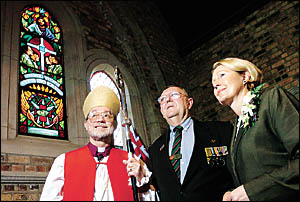 Vietnam veteran Graeme Davis, centre, with the Bishop of Grafton, Right Reverend Keith Slater, left, and Minister for Veterans