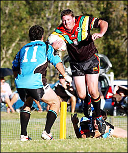 Sawtell Panthers forward Neal McCarthy is airborne as he is ankle-tapped from behind as Port forward Anthony Shipway moves in t
