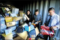 Detectives Vesna Ciric, Darren Cowles and Todd Maguire sort through the stolen property