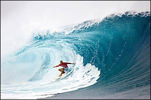 : Kelly Slater on his way to winning his third Billabong Pro with three perfect 10?s at Teahupoo, Tahiti.