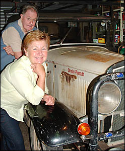 : Kay Dolman with Phil Gander and his 1928 Chrysler, the oldest registered car in Brunswick Heads.