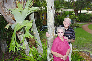 Cec Taylor and his sister, Mae Walker, outside some of the holiday cabins they now plan to replace.