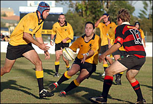 SWASHBUCKINGSTYLE: Yamba Buccaneers try scorer Adrian Miller about to burst onto a pass during Saturday?s history-making win a