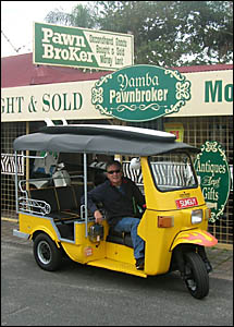Barry Adams and his popular tuk tuk. The name comes from the noise it makes.