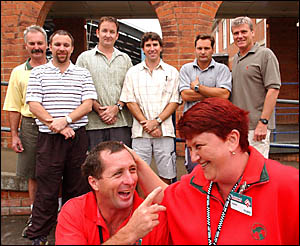 Col Stephens, front left, and Dawn Collison, of Bunnings, promote Bluey Day as Grafton High School teachers Ian Ross, back left