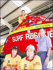 HEAVY WEATHER: Jetboat surf rescue captain Garry Meredith (at rear) with Joe O?Connor (left), mechanic Ross Trease, and Shane O