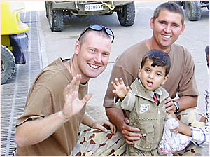 Australian RAAF Airman of the Year, Leading Air Craftsman Michael Barr (left), from Bellingen, served in Iraq in 2003, receivin
