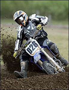 DAVID Wright of Tweed Heads churns the turf at the showgrounds on Saturday in round three of district motorcross action won by