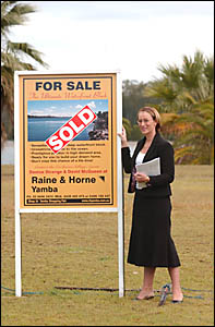 MONEY, MONEY, MONEY: Raine and Horne Yamba principal Denise Strange stands in front of the Palm Terrace block which sold for $9