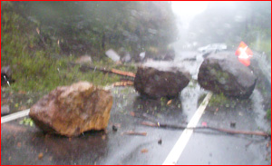 Huge boulders tumbled on to the Cunningham Highway on Wednesday. Picture: Steve Embelton.