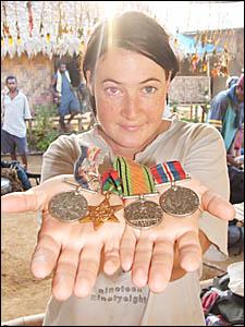 THE DAILY Examiner?s Emma Cornford displays war medals car- ried by the group across the track.
