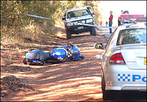 FATAL: The scene of yesterday?s crash on the Orara Way. A motorcyclist from Coffs Harbour was killed.