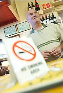 SIGNS UP: Staff at the Albion Hotel in Grafton get ready to phase in the new smoking ban. Pictured is Des Clarke.