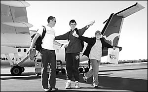 Coffs Harbour teenagers Peter Ball and Blake Moore, with carer Rowan Kimberg, get ready to leave on a trip of a lifetime to Syd