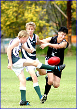 Gladstone Mudcrabs? Martin Lowry (left) gets his kick away under pressure from CQU Panthers under 15 opponent Reece Boyd.