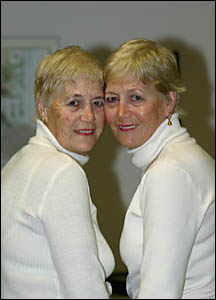 Mary Lems, left, and her twin sister Nell de Graaf, pictured in the same pose taken by a photographer 50 years ago when they ar