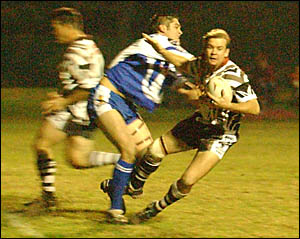 A huge hit from Ghosts five-eighth Donny Dickson sends this Magpie attacker sprawling.