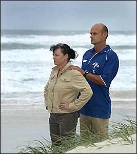 CUDGEN Surf Life Saving Club members Chris Quinlan and Adam Mills survey the beach after helping rescue three people off south