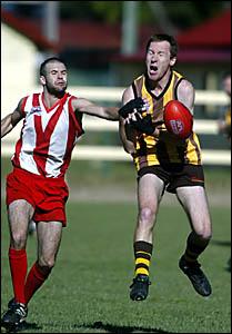 MURWILLUMBAH?S Ross MacFarlane spills the ball as Lismore defend- er Lyndon Dyson spoils during Saturday?s clash.