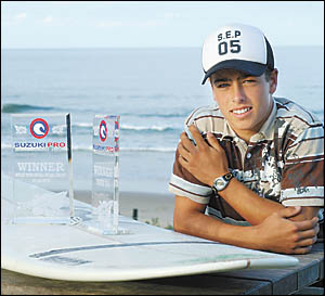 Longboard surfer Cameron Hiscox relaxing at sawtell Beach after taking out the national Suzuki series which culminated with his