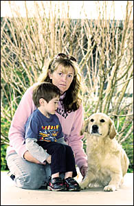 LOST LOVE: Tuncester resident Louise McNamara, with son Connor and dog Liberty. Her family is distraught over the theft of thei