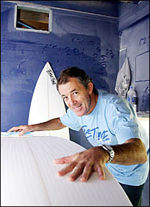 Suurfboard shaper Al Colk with one of his boards that he will donate to a young Fijian surfer.