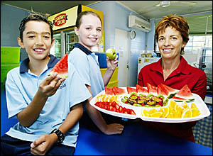 Palm Beach State School?s Olivia Moody, 11, and Reece Blake, 11, dine out on tuckshop convenor Sandy Taylor?s healthy menu opti