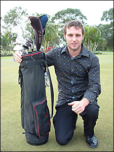 POSITIVEOUTLOOK:Dylan McPhie with the spare set of clubs he will compete with at the Queensland Trainee Championships at Royal