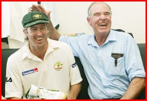 Glenn McGrath shares a joke with his father, Kevin, at the end of the day?s play. Picture: AP PHOTO
