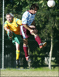 TUMBULGUM?S Ricky Raso (right) heads the ball clear in front of South Tweed Sports? Darren Woodward during their match at Jim D