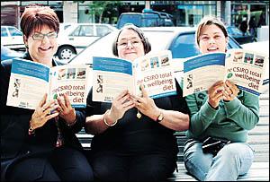 READING UP: Lorraine Olley of Ballina, Barbara Hodgson of The Book Warehouse, and Shennan Thomas of Tuckombil were busy checkin